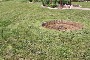 We sprayed a line a rope tied to a round rebar stake to make the outline of the pit and the sitting area.