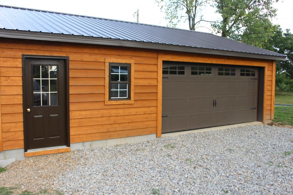 The garage is complete and ready to go! We used the same cedar siding on the house to match