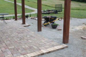 The reclaimed brick patio nears completion - progress now extends out past the posts