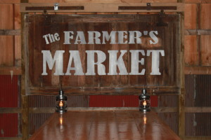 Our Farmers Market sign we made from and old barn door