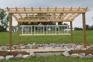 Old windows added to the back of the pergola.