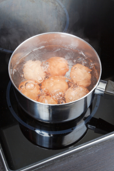 eggs boiling on stove