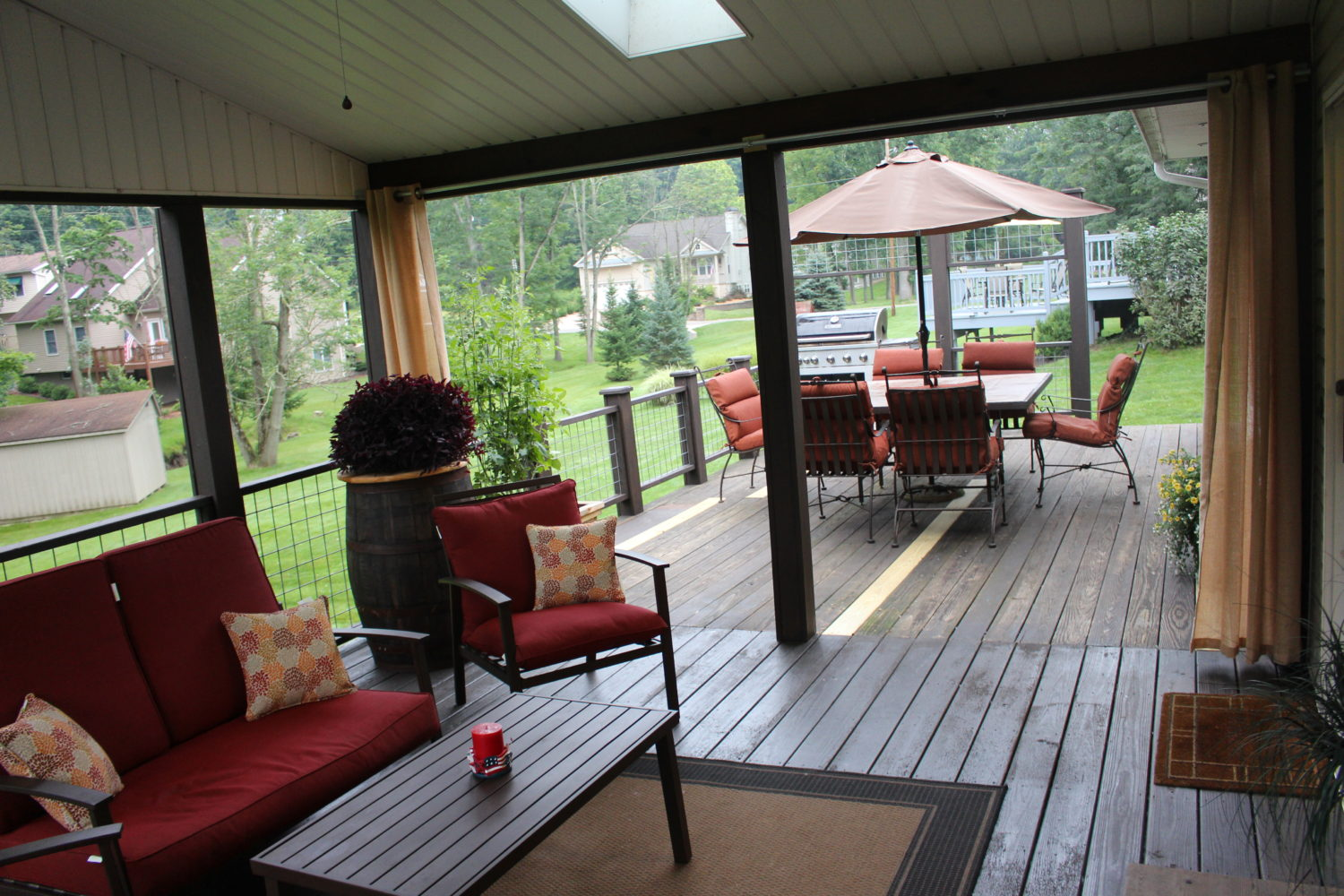creating an outdoor living room from a screened in porch and deck