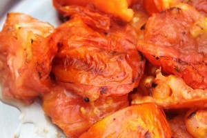 Place charred tomatoes in a bowl and cover with a towel so that the skins can be easily removed.