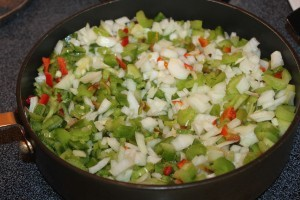 Saute onions, peppers, and garlic to give extra flavor before adding it to the chili mixture.