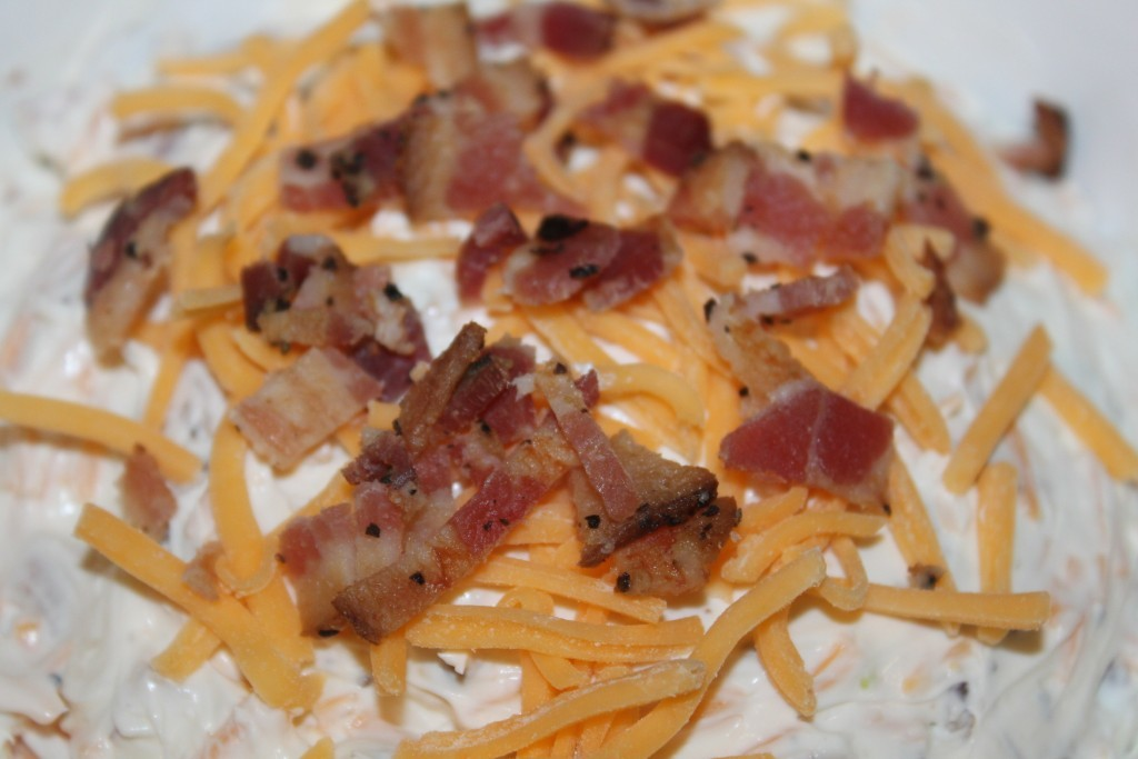Top dip with cheese and bacon for added flavor
