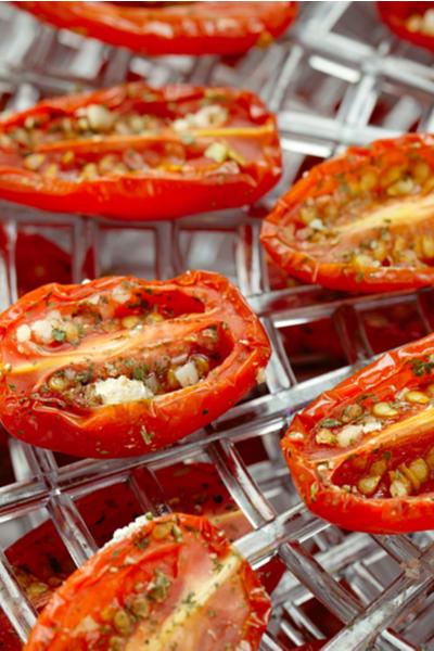 tomatoes on dehydrator rack