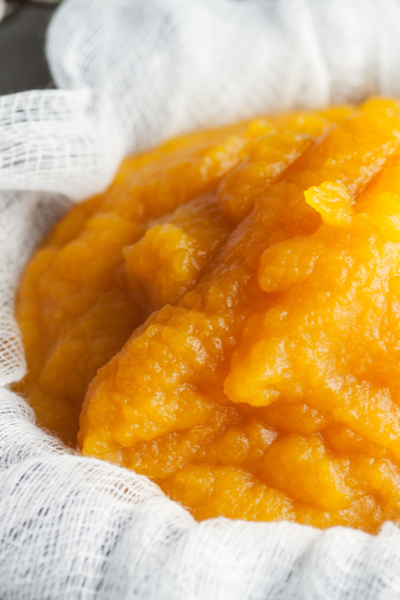 straining pumpkin puree