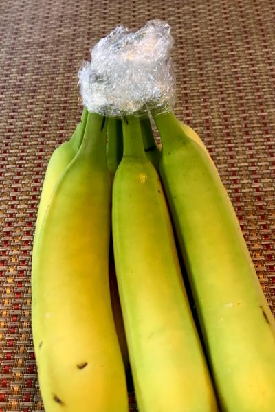plastic on banana stems
